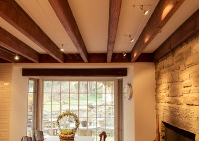 Track lighting installed by Farryn Electric between large wood beams