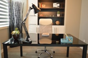 sleek black desk with desk lamp lighting in a home office