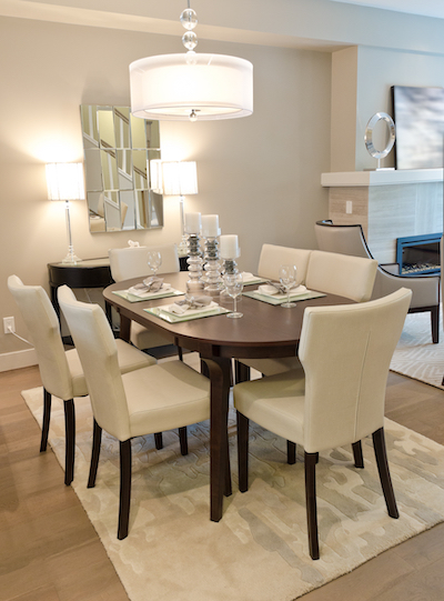 chic dining room with a brown table and white accessories